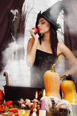 Witch with an apple — Stock Photo