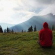 Man meditating in the mountains — Stock Photo #54889573