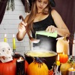 Witch pours secret ingredient — Stock Photo #54892519