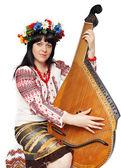 Ukrainian woman playing the bandura — Stock Photo