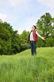 Man with arms outstretched — Stock Photo