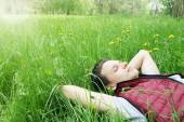 Handsome man lying on the grass — Stock Photo