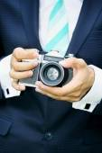 Camera in hand, tinted — Stock Photo