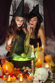 Two witches brew potion — Stock Photo