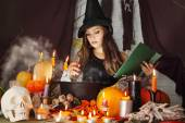 Witch with a book — Stock Photo