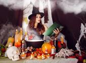 Witch with a glass of blood — Stock Photo