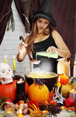 Witch pours secret ingredient — Stock Photo