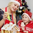 Decorating gingerbread house cream — Stock Photo #60924333