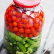 Cherry tomatoes and cucumbers gherkins — Stock Photo #60934777