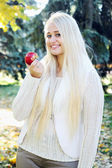 Women with red apple — Stock Photo