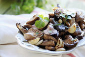 Mushrooms with coriander — Stock Photo