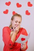 Woman holding card with heart — Stock Photo