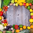 Collection of fresh Fruit and vegetables on wooden table in form — Stock Photo #51891737