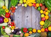 Collection of fresh Fruit and vegetables on wooden table in form — Foto Stock