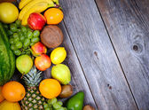 Huge group of fresh colorful fruit on wooden background - High q — Stock Photo