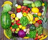 Huge group of fresh vegetables and fruit on wooden background -  — Stock Photo