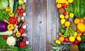 Huge group of fresh vegetables and fruit on wooden background - — Fotografia Stock