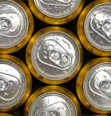 Abstract vie of cold cans with refreshing drink background — Stock Photo