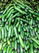 Cucumbers at market background — Stock Photo