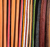 Pile of colorful leather belts — Stock Photo