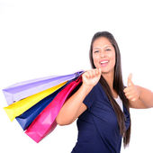 Young beautiful shopping woman on sale holding many colorful sho — Stock Photo