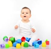 Beautiful baby girl with colorful toys - Studio shot — Stock Photo