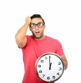Yelling man with big clock in hand isolated on white — Stock Photo
