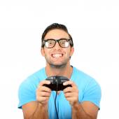 Portrait of handsome man holding joystick for video games agains — Stock Photo