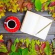 Colorful autumn background with autumnal leaves book and coffee — Stock Photo #57906717