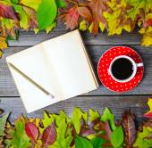 Colorful autumn background with autumnal leaves book and coffee — Stock Photo
