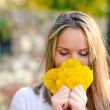 Autumn woman happy with colorful fall leaves — Stock Photo #57912635