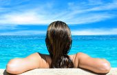 Back view of relaxed woman in blue water — Stock Photo