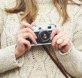 Woman hand holding retro camera close-up — Stock Photo