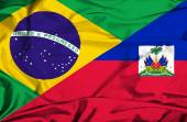 Waving flag of Haiti and Brazil — Fotografia Stock