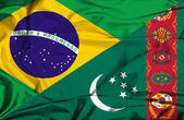 Waving flag of Turkmenistan and Brazil — Stockfoto