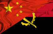 Waving flag of Angola and China — Stock Photo