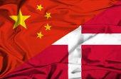 Waving flag of Denmark and China — Zdjęcie stockowe