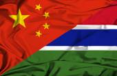 Waving flag of Gambia and China — 图库照片