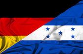 Flagge von Honduras und Deutschland winken — Stockfoto