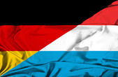 Waving flag of Luxembourg and Germany — Stock Photo