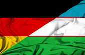 Waving flag of Uzbekistan and Germany — Fotografia Stock