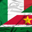Waving flag of Suriname and Italy — Stock Photo #64110491