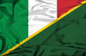 Waving flag of Solomon Islands and Italy — Stock fotografie