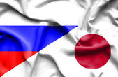 Waving flag of Japan and Russia — Stock Photo