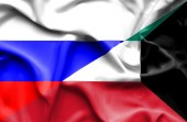 Waving flag of Kuwait and Russia — Stock Photo