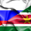 Waving flag of Suriname and Russia — Stock Photo #64121285