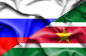 Waving flag of Suriname and Russia — Stock Photo