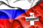 Waving flag of Switzerland and Russia — Stock Photo