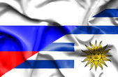 Waving flag of Uruguay and Russia — Stock Photo