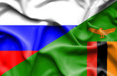 Waving flag of Zimbabwe and Russia — Stock Photo
